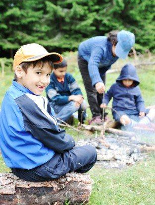 Kozzi-barbecue-in-nature-group-of-children--preparing-sausages-on-fire-314 X 413