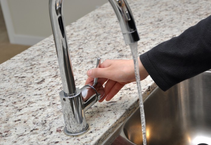 Woman turns on tap water