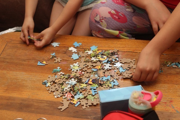 Girls doing puzzle