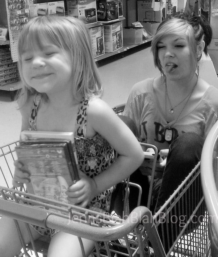catie worden and madisyn worden in basket shopping