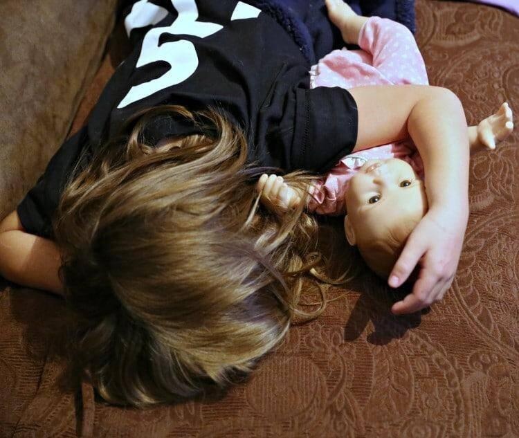 Jenn Worden's daughter sleeping with baby doll