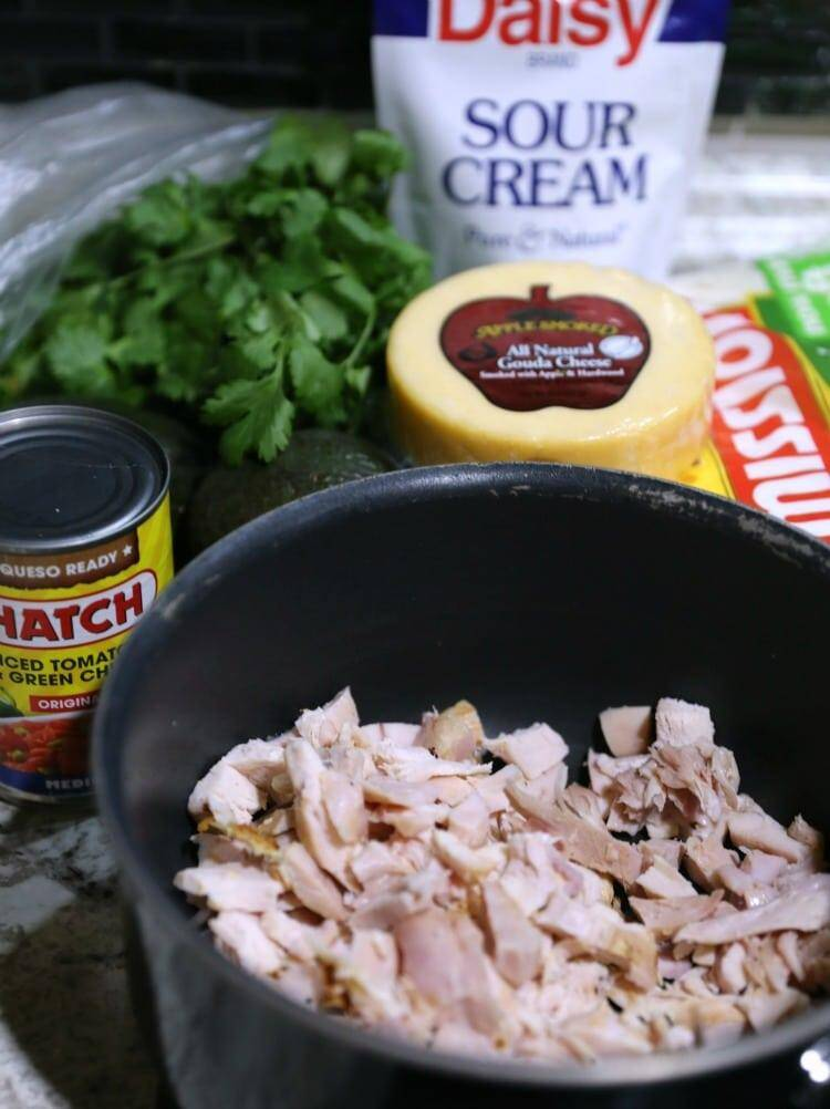 Ingredients to make Chicken Avocado Quesadillas on counter