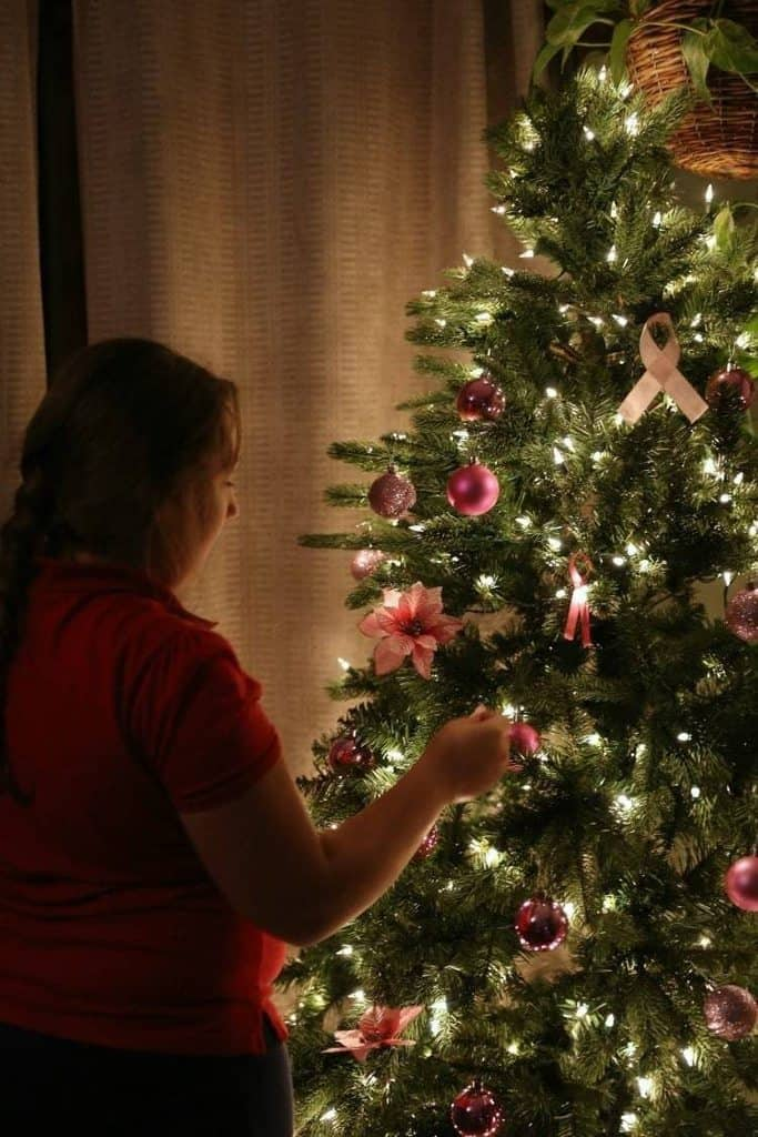 decorating a pink christmas tree