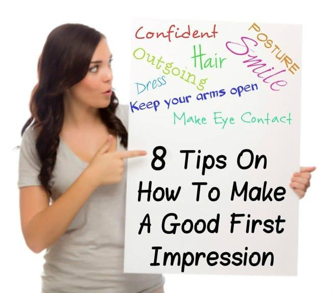 women with brown hair holding a sign that says 8 Tips On How To Make Positive First Impression