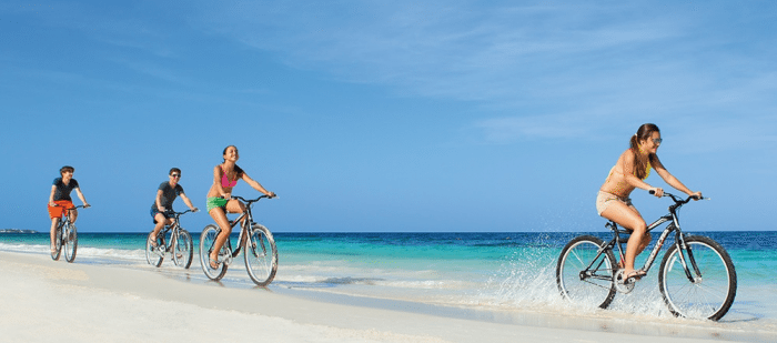 DREAMS PALM BEACH PUNTA CANA Riding Bikes On The Beach