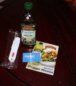 Pompeian Extra Virgin Olive Oil on table with paper and measureing spoon