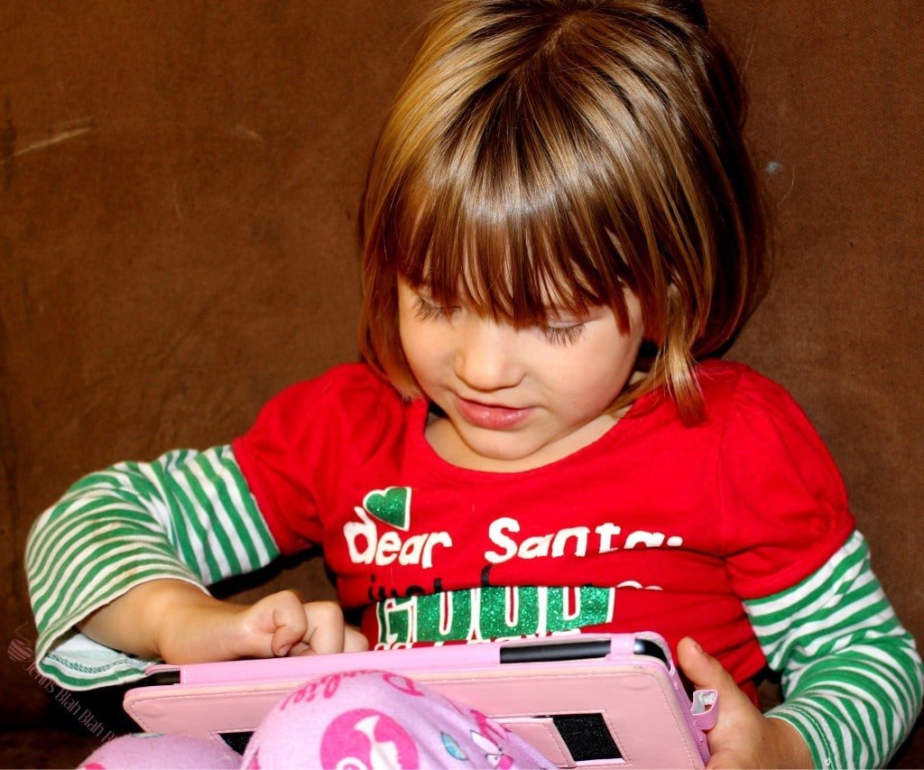 Picture of toddler girl playing with iPad