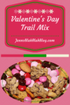 Valentine's Day Recipe: How To Make Valentine's Day Trail Mix on pink backgound with picture of trail mix containing M&Ms, Peanuts, Chocolate Chips, and