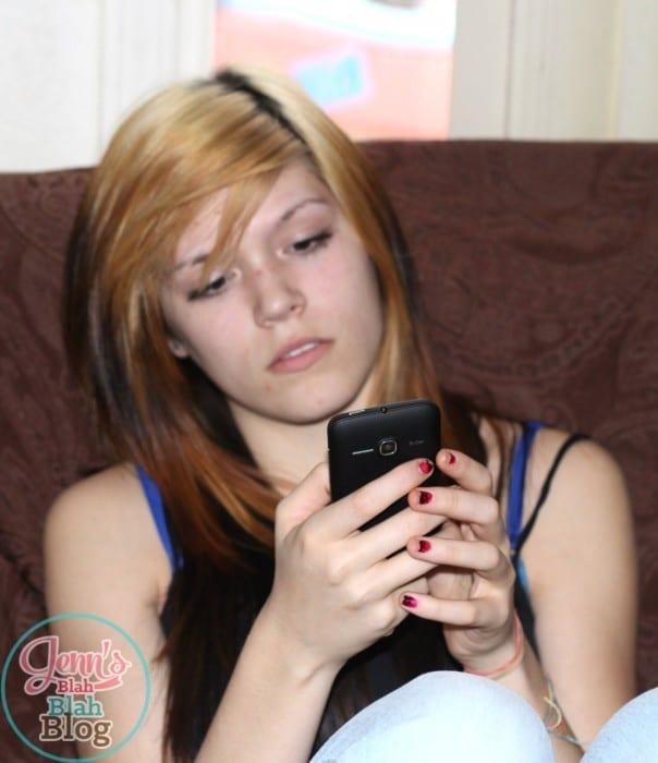teen texting on her new Smartphone #FamilyMobile #CollectiveBias #shop