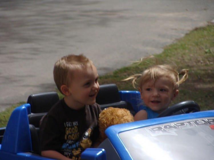 Corbin & Mattie driving blue ford truck