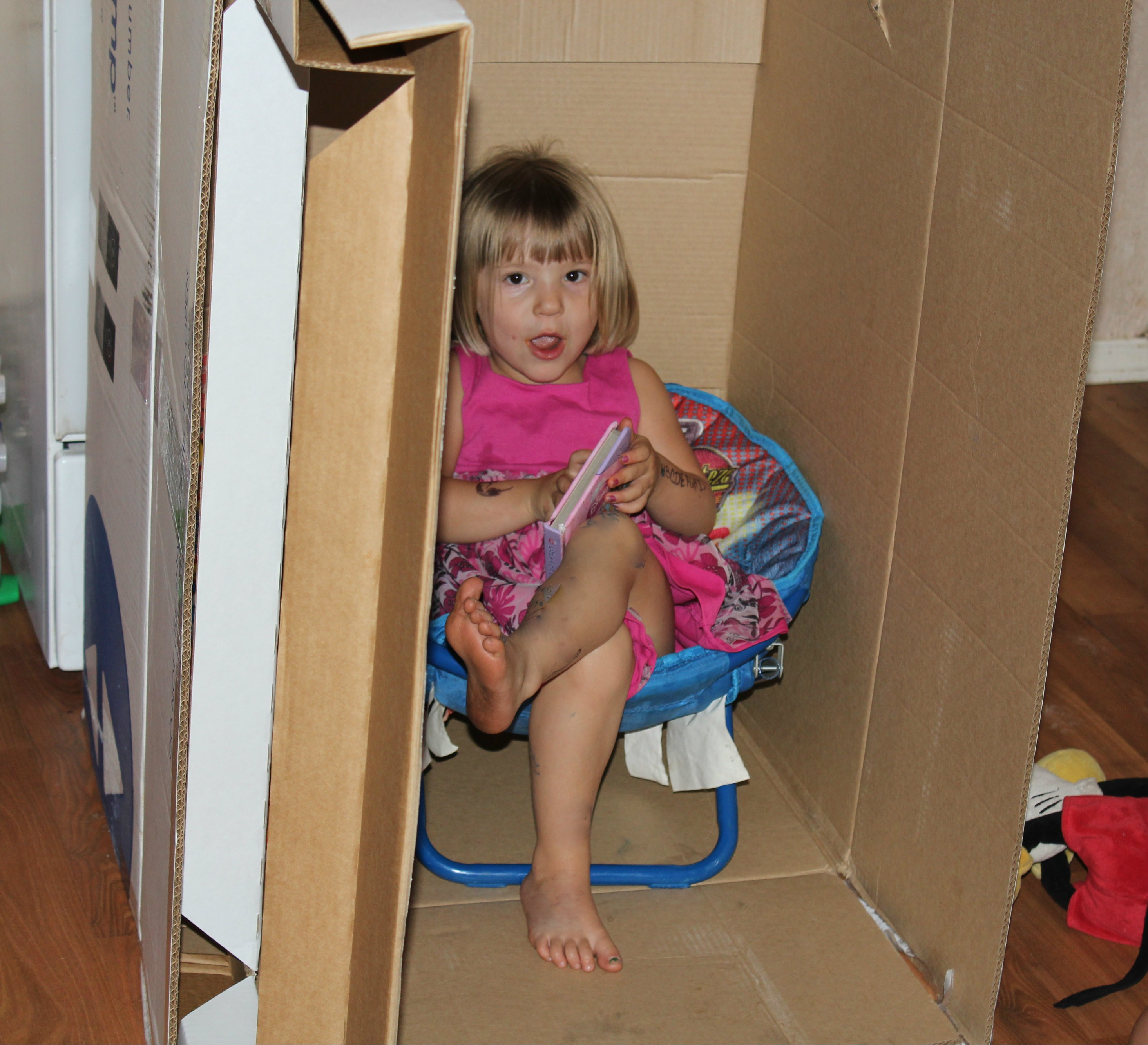 kids having fun with a box