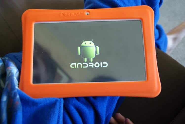 Orange Android Tablet with blank screen only showing the little Android Guy.